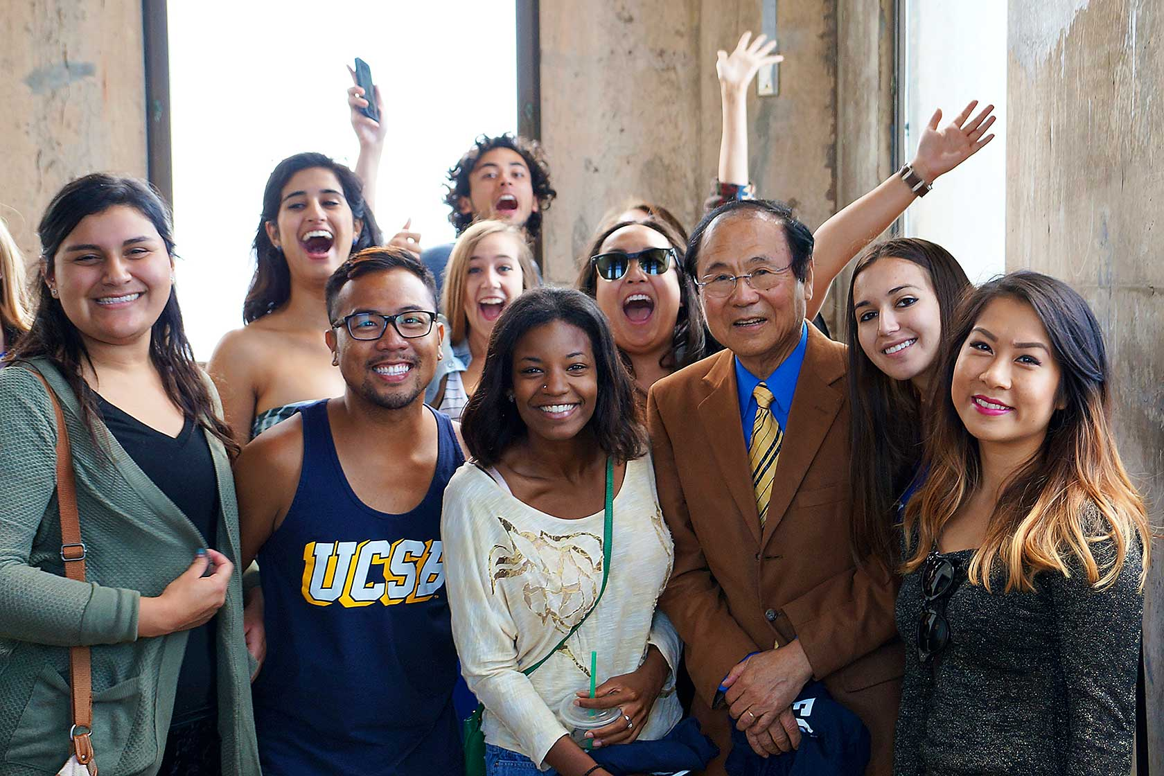 Group of students with Chancellor Yang at Storke Tower